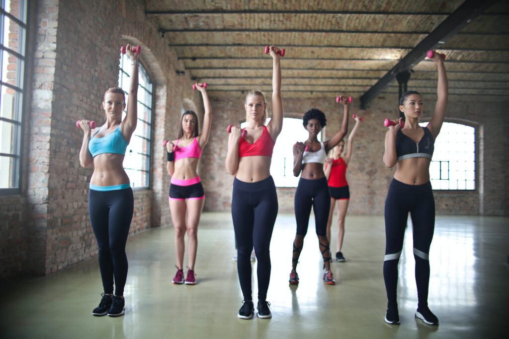 women exercising together after knowing the effect of green tea fat burner pills reviews
